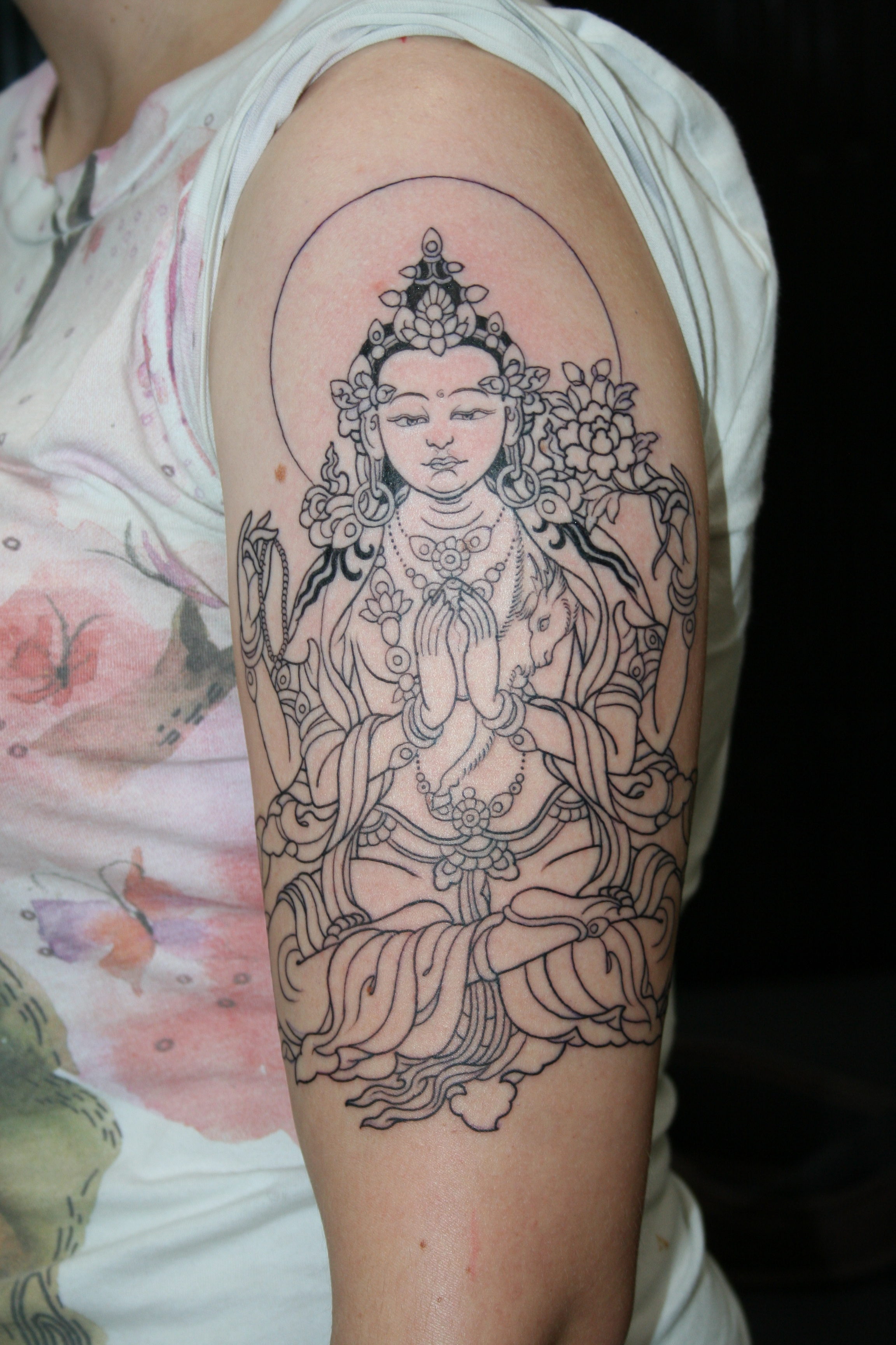 four arm buddha tattooing art by yoni zilber